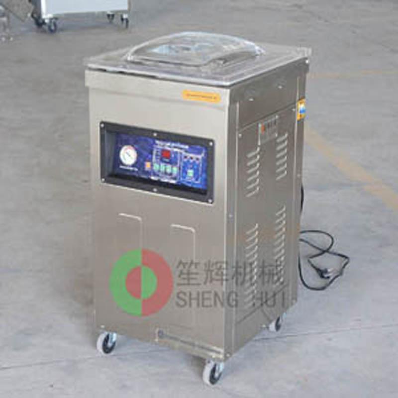 Introducción del papel de la máquina de envasado al vacío de alimentos.
